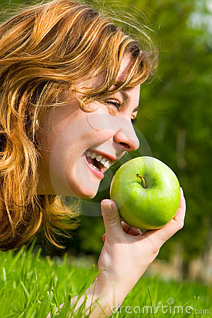 Free Pretty Woman Eating Green Apple Stock Images - 5272344