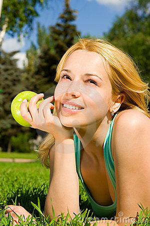 Free Pretty Woman Eating Green Apple Stock Images - 7792404