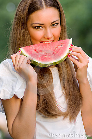 Pretty woman eating watermelon outdoor