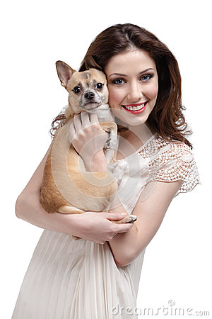 Pretty woman embraces a straw-colored dog