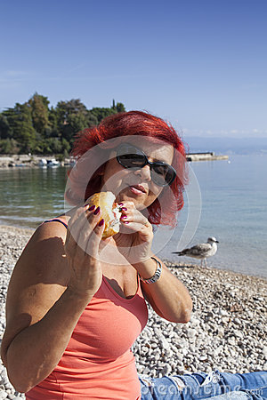 Free Pretty Woman Enjoying Fresh Sea Food Sandwich Stock Image - 45642901