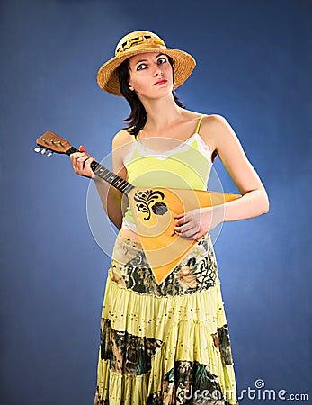 Pretty woman with a folk russian instrument