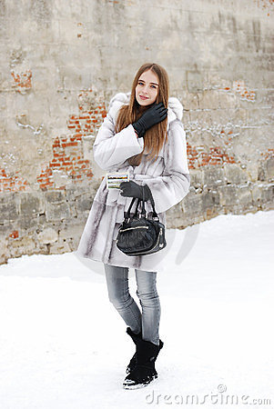 Pretty woman in fur in winter snow