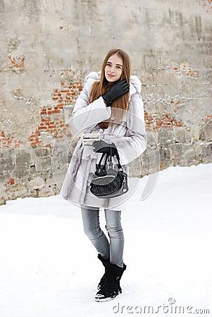 Pretty woman in fur in winter snow