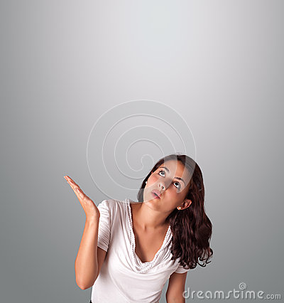 Pretty woman gesturing with copy space