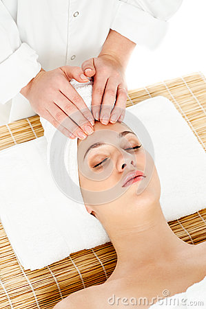 Pretty woman getting head massage
