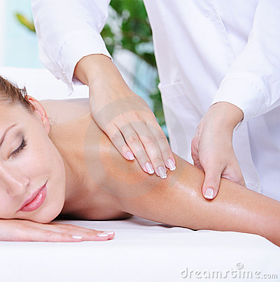 Pretty woman getting massage of shoulder