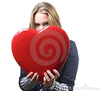 Pretty woman giving a big red heart
