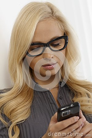 Pretty woman in glasses using mobile