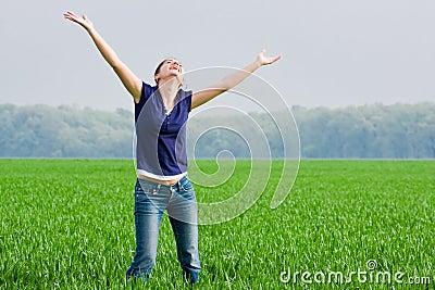 Pretty woman in grassfield