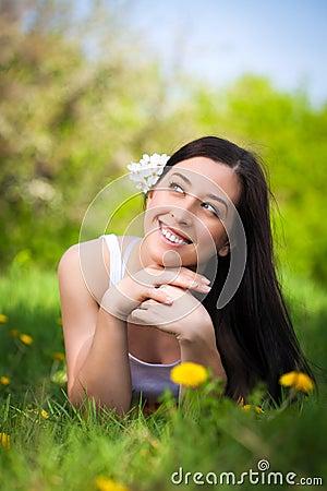 Pretty woman in a green park. summer