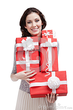 Pretty woman hands a number of gift boxes