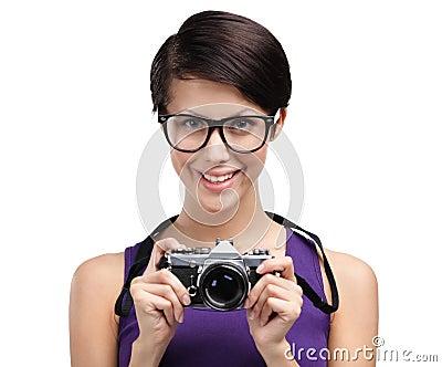Pretty woman hands retro photographic camera
