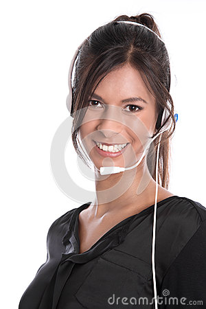 Pretty woman with headset facing camera isolated on white backgr