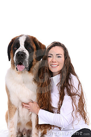 Pretty woman and her Saint Bernard dog side by sid