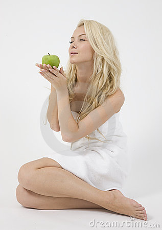 Pretty woman holding an apple