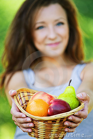 Pretty woman holding basket full