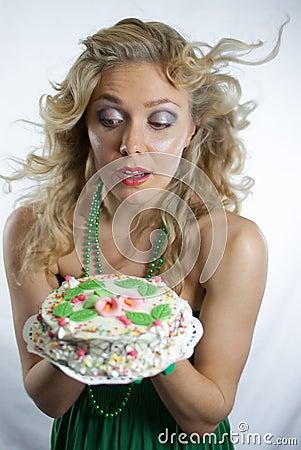 Pretty woman holding birthday cake
