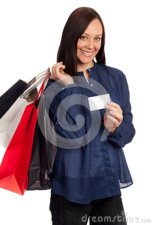 Pretty woman holding shopping bags and credit card