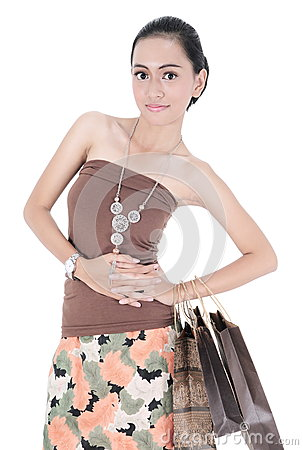 Pretty woman holding shopping bags