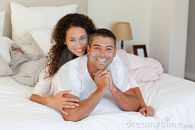 Pretty Woman Hugging Her Husband On Their Bed Royalty Free Stock Photos - Image: 18102078