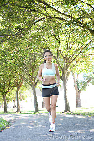 Free Pretty Woman Jogging In Park Stock Photography - 6177352