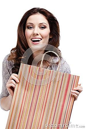 Pretty woman keeps paper gift bag