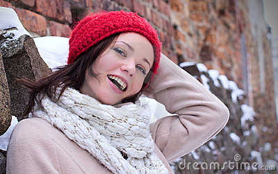 Pretty woman laughing with red cap