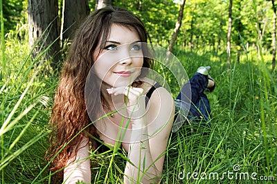 Pretty woman lay in green grass