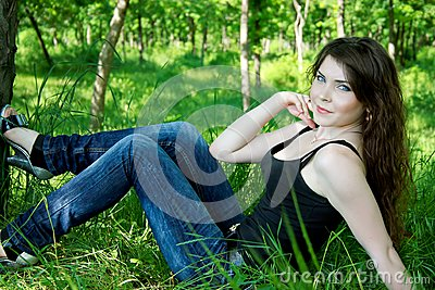 Pretty woman lay in green grass