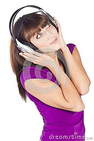 Pretty woman listening, and enjoying music