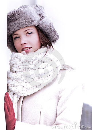 Pretty woman look in winter with furry cap