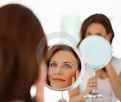 Pretty woman looking into mirror