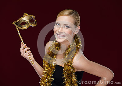 Pretty woman with masquerade mask and tinsel