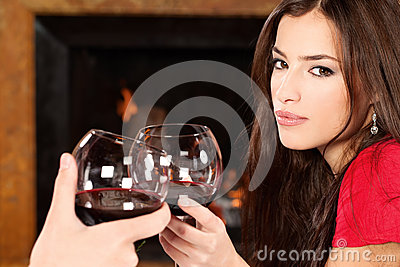 Woman cheers with someone