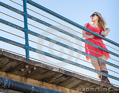 Pretty woman on the pier