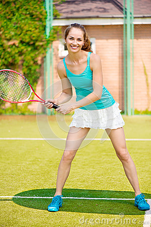 Pretty woman playing tennis