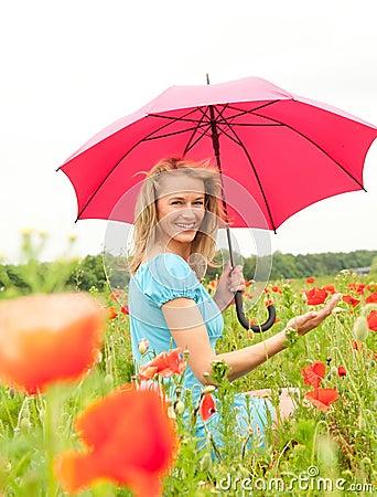 Pretty woman in poppy field