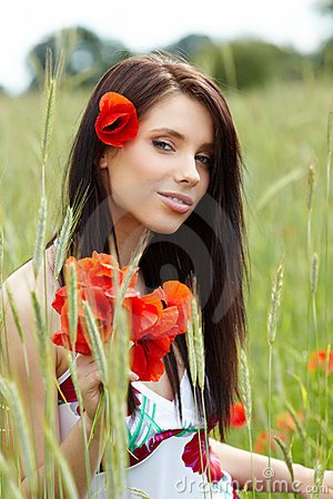 Pretty woman in poppy flowers