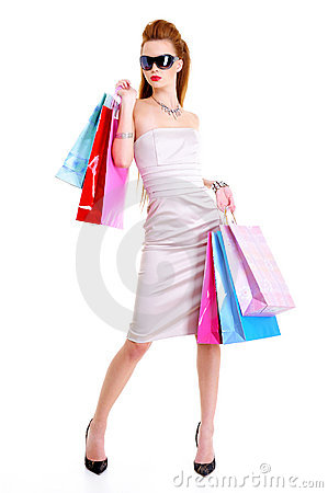 Pretty woman with purchases in hands
