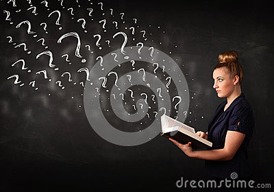 Pretty woman reading a book with question marks coming out from Stock Photo