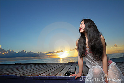 Pretty woman relaxing on sunset