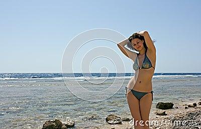 Pretty woman at the sea