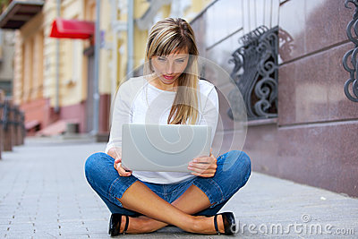 Pretty woman sitting with laptop