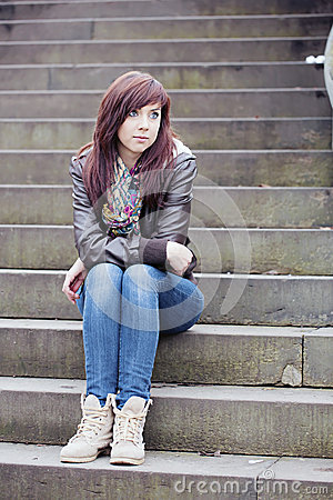 Pretty Woman Sitting on Steps