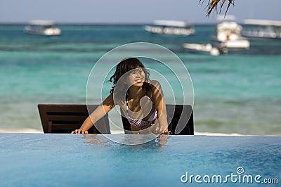 Pretty woman standing on beach