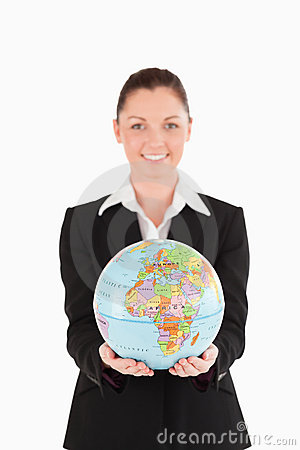 Pretty woman in suit holding a globe
