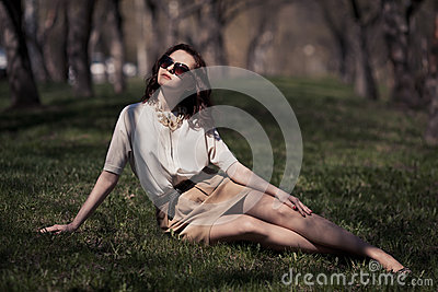 Pretty woman in summer dress outdoors