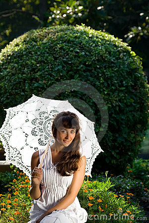 Pretty woman with sun umbrella