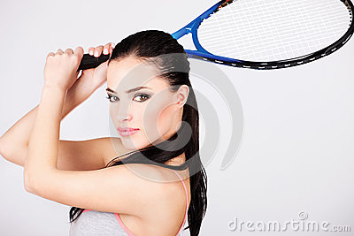 Pretty woman with tennis racket